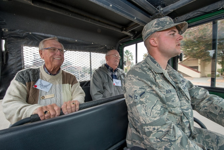 Honorary commanders ride in a gator during their tour of the 60th Mission Support Group, Nov. 3, 2017, at Travis Air Force Base, Calif. The purpose of the Travis honorary Commander Program is to promote relationships between base senior leadership and civilian partners, foster civic appreciation of the Air Force mission and its Airmen, maximize opportunities to share the Air Force story with new stewards, and to communicate mutual interest, challenges, and concerns that senior leaders and civilian stakeholders have in common. (U.S. Air Force photo by Louis Briscese)