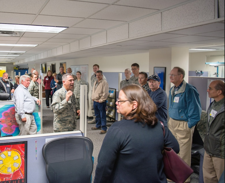Honorary commanders visit the 60th Communication Squadron during a tour of the 60th Mission Support Group, Nov. 3, 2017, at Travis Air Force Base, Calif.  The purpose of the Travis Air Force Base Honorary Commander Program is to promote relationships between base senior leadership and civilian partners, foster civic appreciation of the Air Force mission and its Airmen, maximize opportunities to share the Air Force story with new stewards, and to communicate mutual interest, challenges, and concerns that senior leaders and civilian stakeholders have in common. (U.S. Air Force photo by Louis Briscese)