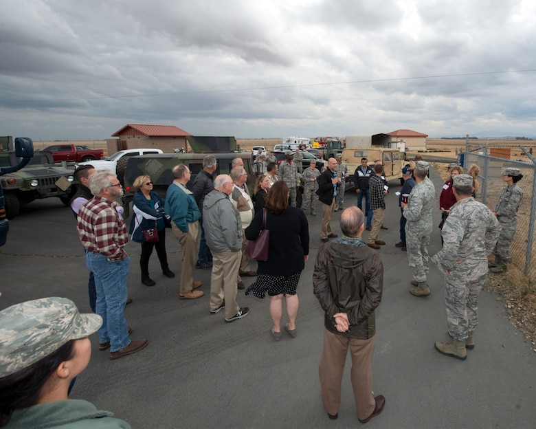 Honorary Commanders from Travis Air Force Base, Calif., prepare for their tour of the 60th Mission Support Group, Nov. 3, 2017 at Travis Air Force Bace, Calif.  The purpose of the Travis Air Force Base Honorary Commander Program is to promote relationships between base senior leadership and civilian partners, foster civic appreciation of the Air Force mission and its Airmen, maximize opportunities to share the Air Force story with new stewards, and to communicate mutual interest, challenges, and concerns that senior leaders and civilian stakeholders have in common. (U.S. Air Force photo by Louis Briscese)