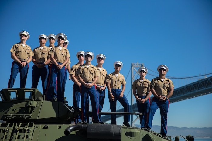 U.S. Marines with 3rd Light Armored Reconnaissance, 1st Marine Division, pose for a group photo on top of an LAV 25 A2 aboard the USS Essex LHD2 during the parade of ships during San Francisco Fleet Week Oct. 6, 2017. San Francisco Fleet Week is an opportunity for the American public to meet their Marine Corps, Navy and Coast Guard teams and experience America's sea services. Fleet Week will highlight naval personnel, equipment, technology and capabilities, with an emphasis on humanitarian assistance and disaster relief. (U.S. Marine Corps photo by Sgt. Rodion Zabolotniy)