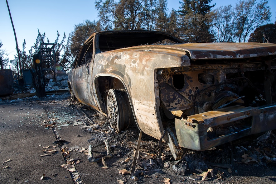A burned out car lies in front of the remains of a house that was destroyed by the California wildfire in Santa Rosa, Calif., on Oct. 31, 2017. The recent wildfires destroyed more than 15,000 homes and caused more than $3 billion in damages.
