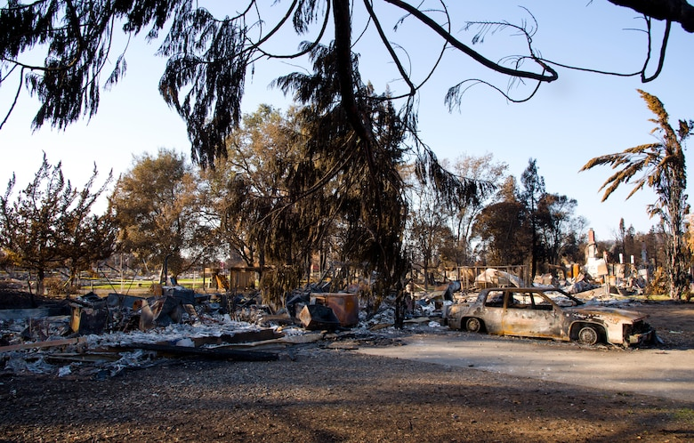 The neighborhood of Senior Airman Martin Baglien, 349th Civil Engineer Squadron firefighter, family's home lies in ruin after the California wildfire in Santa Rosa, Calif., on Oct. 31, 2017. The recent wildfires consumed more than 15,000 homes, and caused at least $3 billion in damage. The city of Santa Rosa alone lost 5 percent of it's housing.