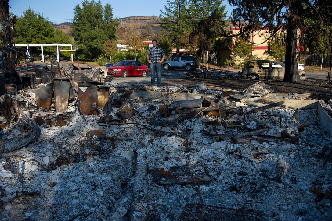 Senior Airman Martin Baglien, 349th Civil Engineer Squadron firefighter, inspects the damage to his family's home that was decimated by the California wildfire in Santa Rosa, Calif., on Oct. 31, 2017. The recent fires destroyed more than 15,000 homes.