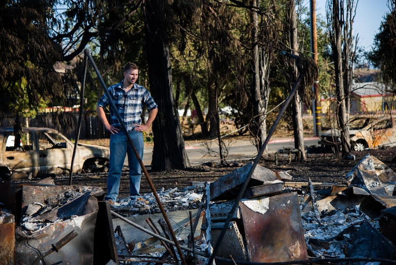 Senior Airman Martin Baglien, 349th Civil Engineer Squadron firefighter, surveys the remains of his family's home after the California wildfire in Santa Rosa, Calif., on Oct. 31, 2017. The recent wildfires consumed more than 15,000 homes, and caused at least $3 billion in damage.
