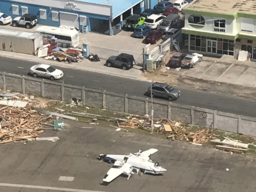 A civilian aircraft rests on its top at a St. Croix airport in this aerial view taken Sept. 17, 2017 from a C-130 Hercules assigned to the 120th Airlift Wing. Members of the Montana Air National Guard witnessed the devastation left behind during a mission to provide relief for Hurricane Maria. (U.S. Air National Guard photo/Master Sgt. Benjamin Webb)