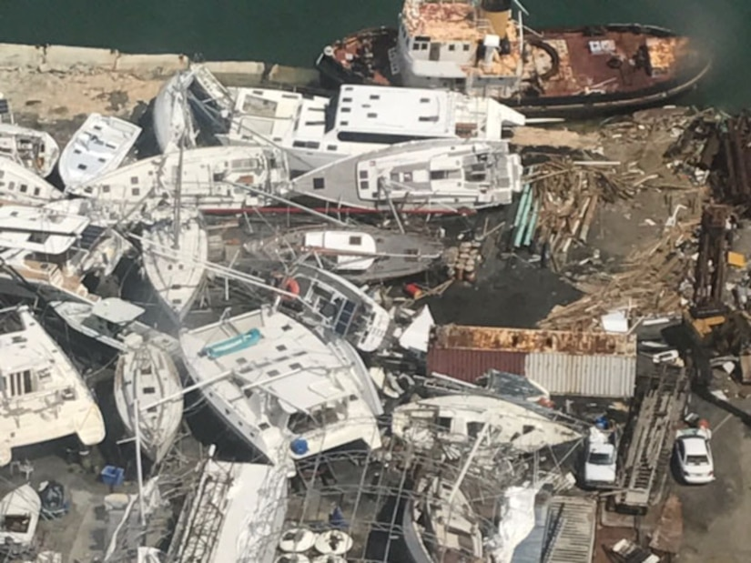 Boats are seen shoved together and pushed on shore in this aerial view taken Sept. 17, 2017 from a C-130 Hercules assigned to the 120th Airlift Wing. Members of the Montana Air National Guard witnessed the devastation left behind during a mission to provide relief for Hurricane Maria. (U.S. Air National Guard photo/Master Sgt. Benjamin Webb)