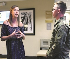 Kelly Johnson from Woodway Apartments in Manhattan, Kansas, talks with Pfc. Brian Long during an IHG Social at the Candlewood Suites at Fort Riley.