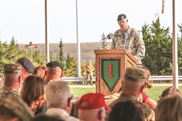 Brig. Gen. William A. Turner, deputy commanding general for support, 1st Infantry Division, speaks to guests and family member during a Victory with Honors ceremony Sept. 27 at the division headquarters. Turner retired from the Army after 31 years of service during the ceremony and three assignments with the 1st Inf. Div., including two combat deployments to Iraq while with the division.