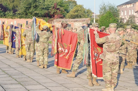 Soldiers from the 2nd Armored Brigade Combat Team, 1st Infantry Division, uncase unit colors in a rehearsal for the transfer of authority ceremony at Market Square, Zagan, Poland, Sept. 29. Command and responsibility of being the only armored brigade combat team in Europe transitions from 3rd Armored Brigade Combat Team, 4th Infantry Division, to 2nd ABCT, 1st Inf. Div. The ceremony is the first of its type to occur in Poland. The 2nd ABCT is currently in Poland to support Atlantic Resolve, a U.S. endeavor to fulfill NATO commitments by rotating U.S.-based units throughout the European theater and training with NATO allies and partners.