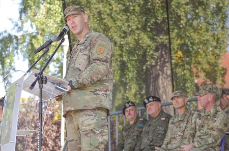 Col. David Gardner, commander, 2nd Armored Brigade Combat Team, 1st Infantry Division, speaks during a transfer of authority ceremony in Market Square, Zagan, Poland, Sept. 29. The ceremony marks the transfer of command and responsibility of being the only armored brigade combat team in Europe from 3rd Armored Brigade Combat Team. 4th Infantry Division to 2nd Armored Brigade Combat Team.