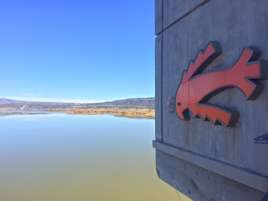 COCHITI LAKE, N.M. – A close up view of the Cochiti symbol on the control tower at the dam with the lake in the background, Oct. 26, 2017. Photo by Ashley Tellier. This was a 2017 Photo Drive entry.