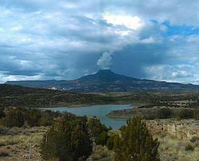 ABIQUIU LAKE, N.M. – Clouds appear to steam out like a volcano from the Cerro Pedernal in this photo taken from the Puerco campground, April 1, 2017. Photo by Clarence Maestas. This was a 2017 Photo Drive entry.