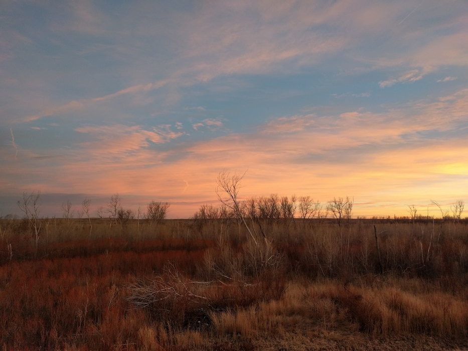 FORT LYON, Colo., -- The sunset as seen from the top of the Forty Lyon Levee near the Arkansas River, Jan. 31, 2017. Photo by Kara Hickey. This was a 2017 Photo Drive entry.