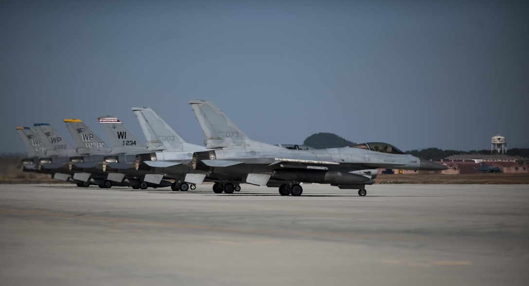 "U.S. Air Force pilots assigned to the 8th Fighter Wing and 115th Fighter Wing with Republic of Korea Air Force pilots assigned to the 38th Fighter Group wait to takeoff at Kunsan Air Base, Republic of Korea, Oct. 30, 2017. The pilots carried out a ""Friendship Flight"" mission, continuing a long partnership of mutually strengthening cross-cultural communications and mission capabilities, ultimately enabling a better posture to execute the combat mission of ""Take the Fight North"" if called upon to do so. (U.S. Air Force photo by Staff Sgt. Victoria Taylor"