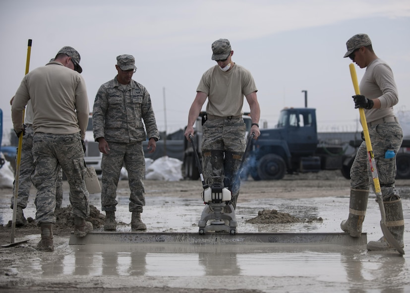 U.S. Air Force Airmen assigned to the 8th Civil Engineer Squadron finish patching a damaged area during rapid airfield damage repair training at Kunsan Air Base, Republic of Korea, Oct. 26, 2017. Members from the Air Force Civil Engineer Center, Tyndall Air Force Base, Fla., instructed Airmen assigned to the 8th CES on the new RADR process. (U.S. Air Force photo by Staff Sgt. Victoria H. Taylor)
