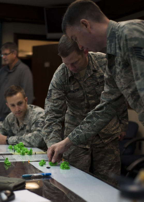 U.S. Air Force Airmen assigned to the 8th Civil Engineer Squadron participate in the strategic planning portion of rapid airfield damage repair training at Kunsan Air Base, Republic of Korea, Oct. 25, 2017. The new RADR process was developed by the Air Force Civil Engineer Center to repair damaged airfields at a faster pace. (U.S. Air Force photo by Staff Sgt. Victoria H. Taylor)
