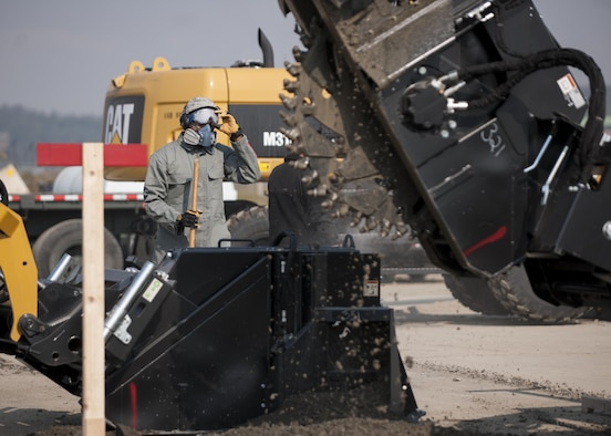 U.S. Air Force Senior Airman Gollie Felder, 8th Civil Engineer Squadron Pest Management journeyman, participates in rapid airfield damage repair training at Kunsan Air Base, Republic of Korea, Oct. 25, 2017. The new RADR process was developed by the Air Force Civil Engineer Center to repair damaged airfields at a faster pace. (U.S. Air Force photo by Staff Sgt. Victoria H. Taylor)