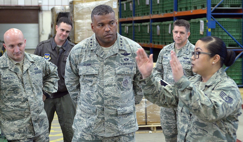 U.S. Air Force Lt. Gen. Richard M. Clark, 3rd Air Force commander, toured the 100th Logistics Readiness Squadron Nov. 6, 2017, on RAF Mildenhall, England. Clark listened as Staff Sgt. Tiani Talledo, 100th LRS individual protective equipment Supervisor, described the innovations they have made for deployment readiness. (U.S. Air Force photo by Airman 1st Class Benjamin Cooper)