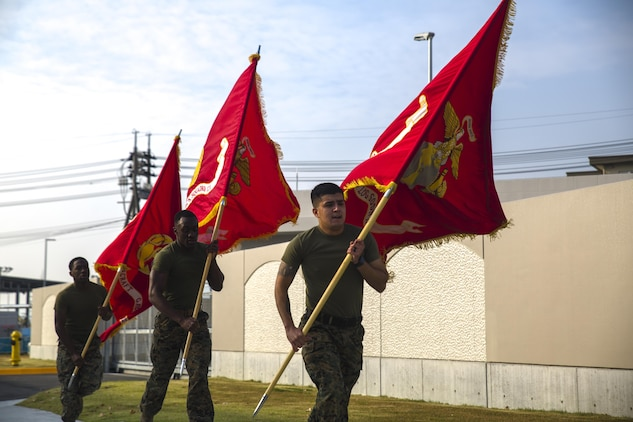 MAG-12 runs their battle colors in support of 1st MAW's 242-mile run