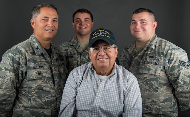 Col. Randy Huffman, vice wing commander of the 130th Airlift Wing, poses with his father, Senior Master Sgt. Danny Huffman, and sons Senior Airman Adam Huffman and Staff Sgt. Kyle Huffman.