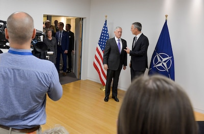 Defense Secretary Jim Mattis and NATO Secretary General Jens Stoltenberg speak before a one-on-one meeting at NATO headquarters in Brussels, Nov. 8, 2017. NATO photo