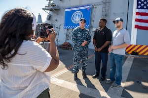 "Navy Lt. Cmdr. Brett Ringo leads a tour of the littoral combat ship USS Freedom as part of a pre-taped segment for ESPN's show ""First Take,"" in San Diego, Nov. 5, 2017. More than 150 sailors, veterans, family members and friends took part in the live broadcast on Nov. 6 of the show's ""A Salute to America's Heroes,"" in celebration of Veterans Day. Navy photo by Petty Officer 1st Class Chad M. Butler"