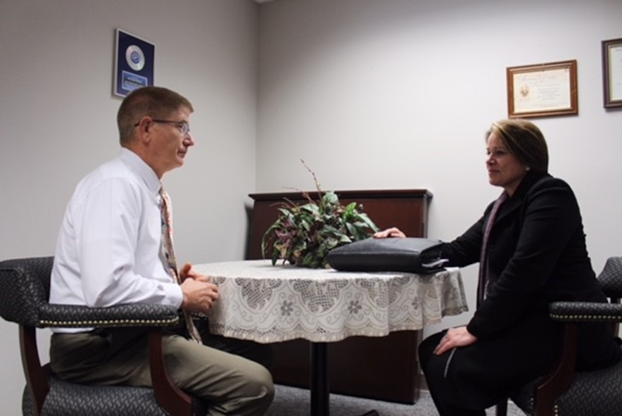 National Background Investigation Bureau Special Agent Josephine Dow meets with Jim Mitchell, 88th Air Base Wing Public Affairs operations chief, to finalize his personnel security investigation. The Air Force currently has more than 90,000 personnel security investigations backlogged. To mitigate, temporary National Background Investigation Bureau satellite hubs will be established on Air Force installations with large numbers of backlogged personnel security investigations.