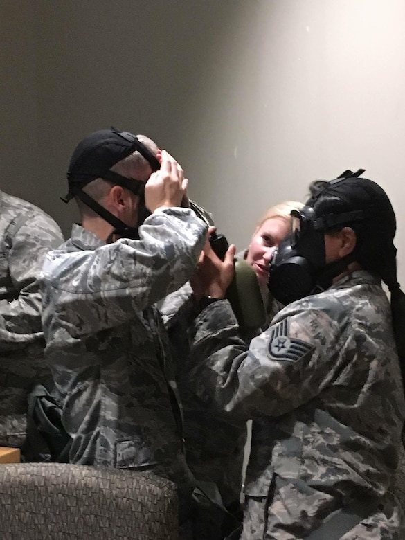 Members of the 507th Air Refueling Wing practice gas mask procedures during CBRN training Aug. 6, 2017 at Tinker Air Force Base, Okla. (U.S. Air Force photo/Tech. Sgt. Samantha Mathison)