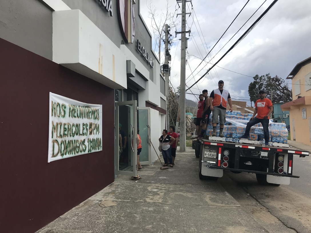 UTUADO, Puerto Rico – Richard Dessert, second from right, a Washington Air National Guard master sergeant, prepares to unload relief supplies gathered from the Puerto Rico National Guard distribution point in Utuado to a staging point at the El Calvario Church Oct. 5, 2017.  Dessert volunteered to deploy in support of his civilian employer, World Vision, to provide Hurricane Maria relief and IT support.  (Courtesy photo by Richard Dessert)