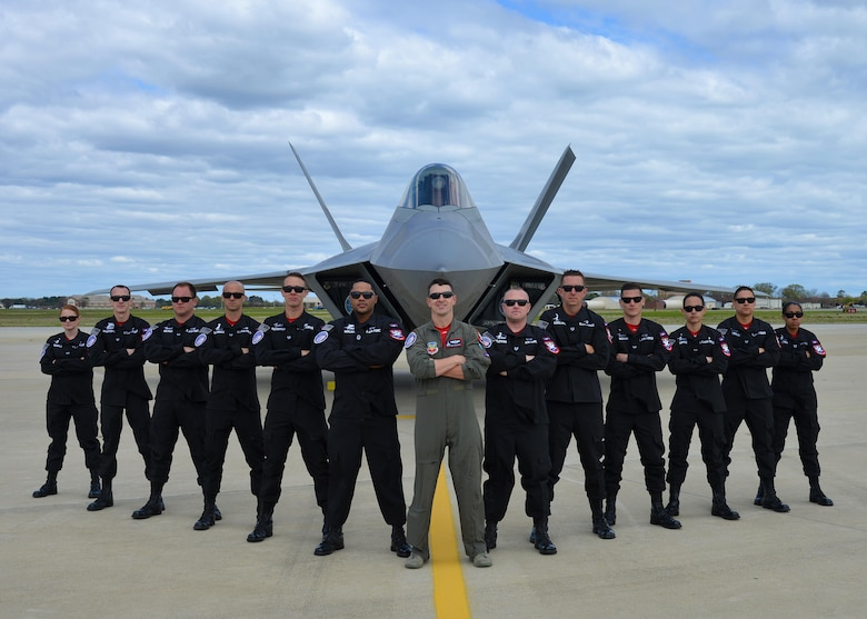 F-22 Raptor Demonstration Team pose for photo in front of an F-22 Raptor