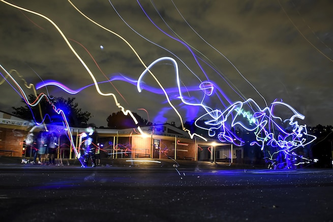 Light beams show as squiggle in the air.