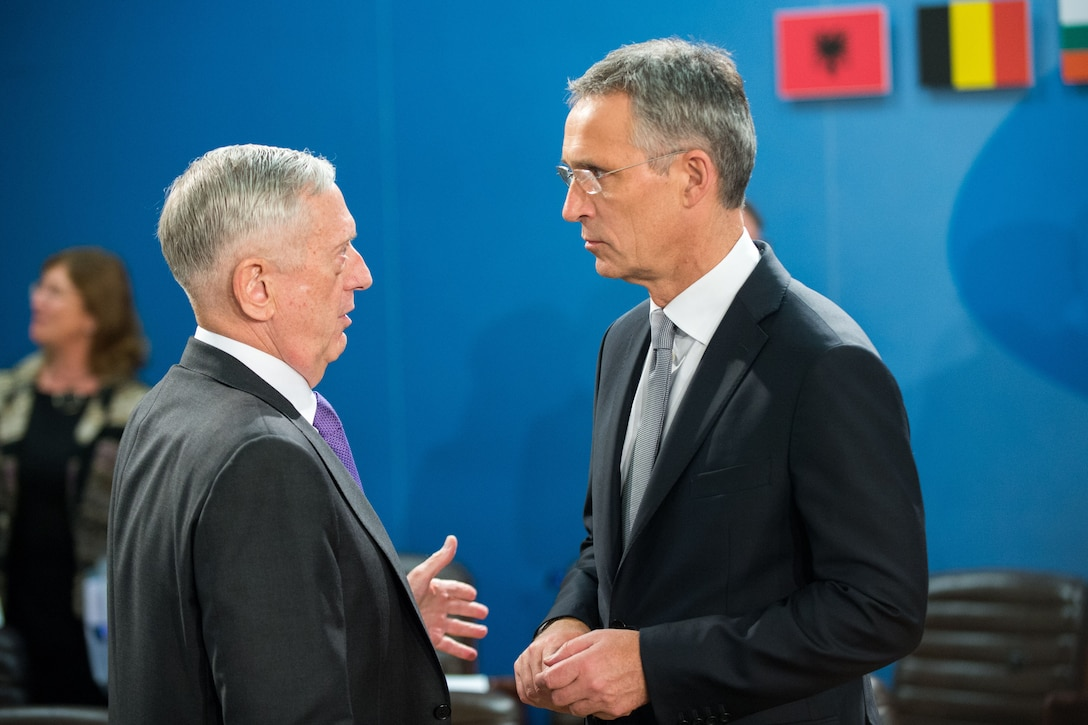 Two leaders talk during a NATO meeting in Brussels.