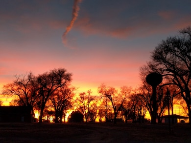 FORT LYON, Colo., -- The sunset as seen from the top of the Fort Lyon Levee looking towards Fort Lyon, Jan. 31, 2017. Photo by Kara Hickey. This was a 2017 Photo Drive entry.
