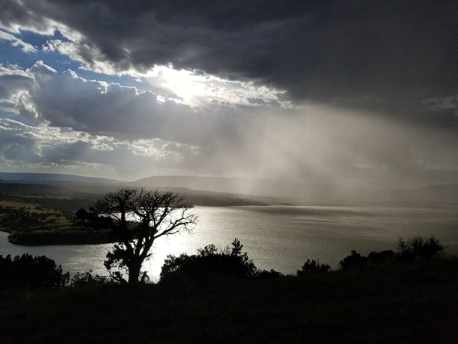 ABIQUIU LAKE, N.M. – A rainstorm moves in over the lake, Aug. 1, 2017. Photo by Jeffery Austin. This 2017 Photo Drive entry placed second based on employee voting.