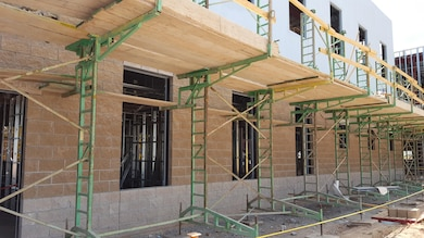 CANNON AIR FORCE BASE, N.M. – Scaffolding along the outside of the new Medical and Dental Clinic as it was constructed, Oct. 18, 2017. Photo by James Vigil. This was a 2017 Photo Drive entry.