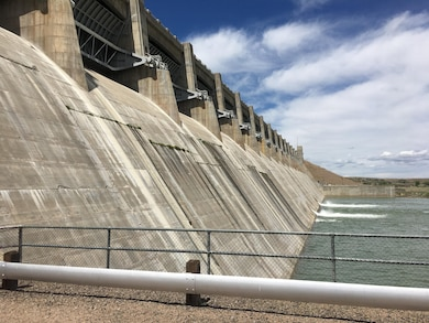 JOHN MARTIN DAM, Colo., -- The dam is used for flood control, irrigation, and recreation. In this photo, taken April 27, 2017, two of the service gates are open to supply irrigation needs downstream. Photo by Richard Negri. This was a 2017 Photo Drive entry.
