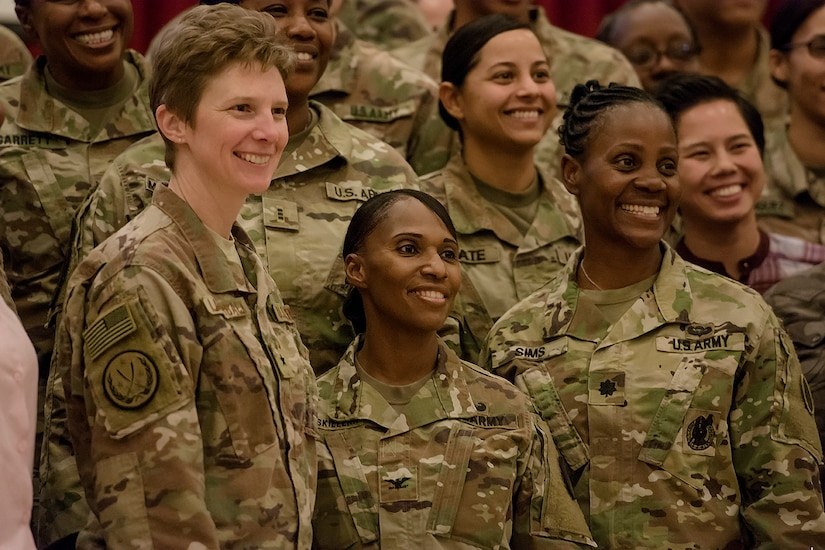 Female Soldiers pose for a photo.