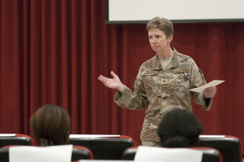 Female Soldier giving a speech.