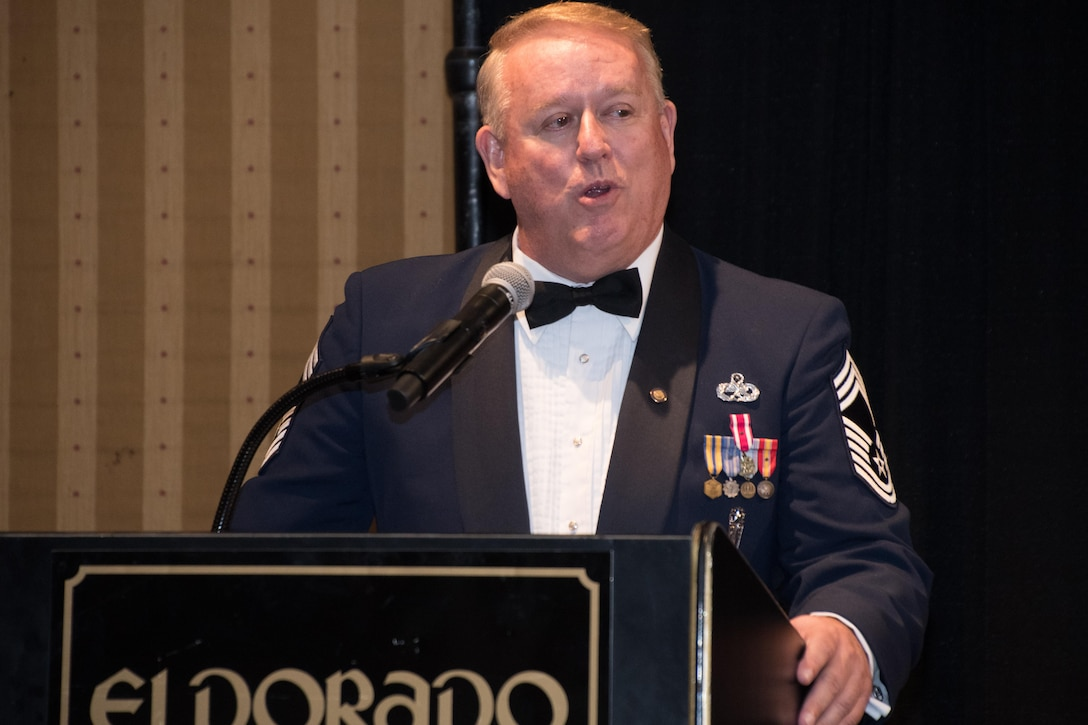 Retired Chief Master Sgt. Paul LaFlame, president of the Louisiana State Air Force Association, talks about the importance of taking care of Airmen during the 307th Bomb Wing Senior Noncommissioned Officer Induction and Chief Recognition Ceremony in Shreveport, La. Nov. 4, 2017.