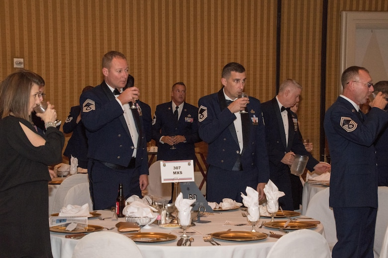 Airmen drink after a ceremonial toast to open the 307th Bomb Wing Senior Noncommissioned Officer Induction and Chief Recognition Ceremony in Shreveport, La., Nov. 4, 2017.