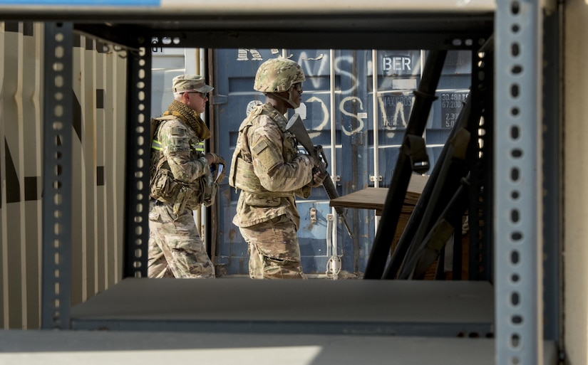 Two Soldiers conduct foot patrol during training.