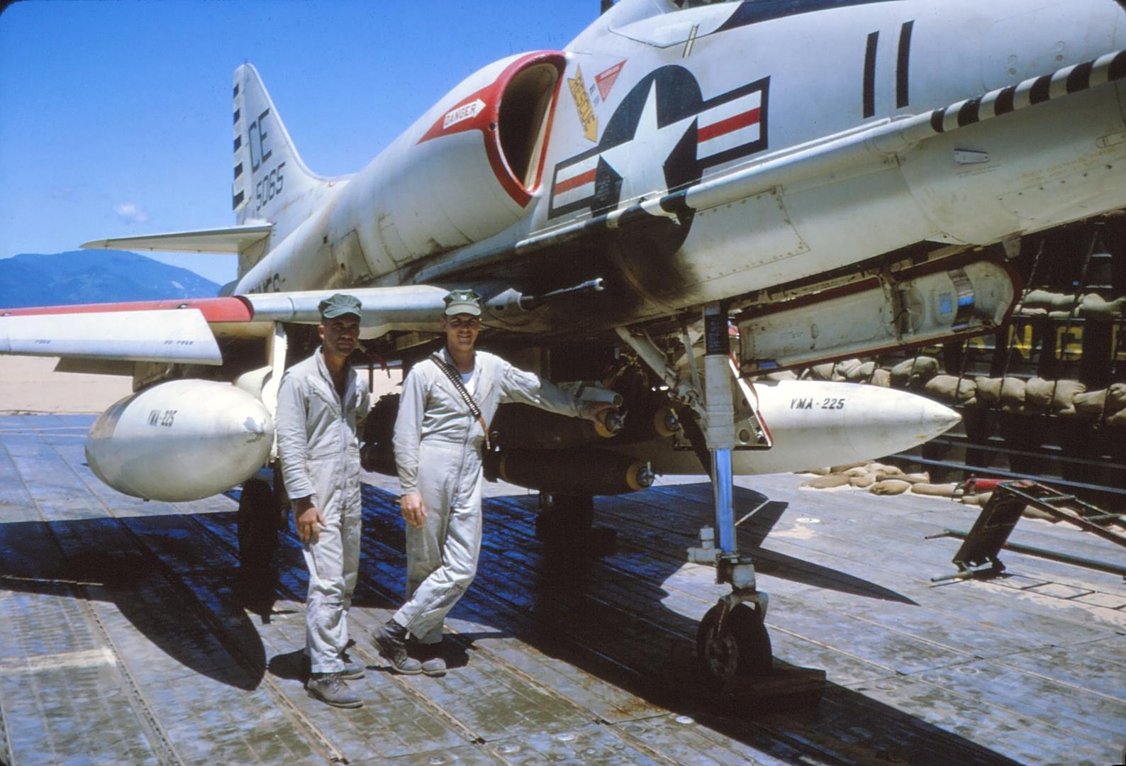 Two pilots from Marine Attack Squadron (VMA) 225 stand in front of a Douglas A4 Skyhawk at Chu Lai Air Base, Vietnam in 1965 (Courtesy photo / Rich Lee)