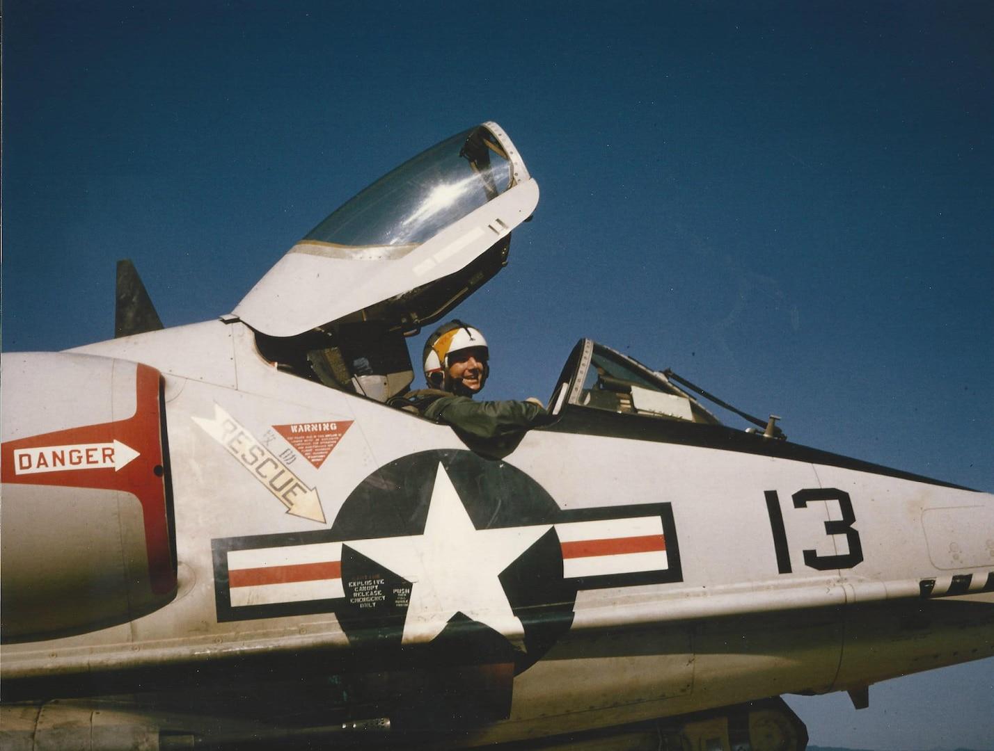 "1st Lt Conrad ""Ham"" Hamilton sits in the cockpit of a Douglas A4 Skyhawk following the 1000th mobile arresting gear landing (MOREST) at Chu Lai Air Base, Vietnam. (Courtesy photo/ Rich Lee)"