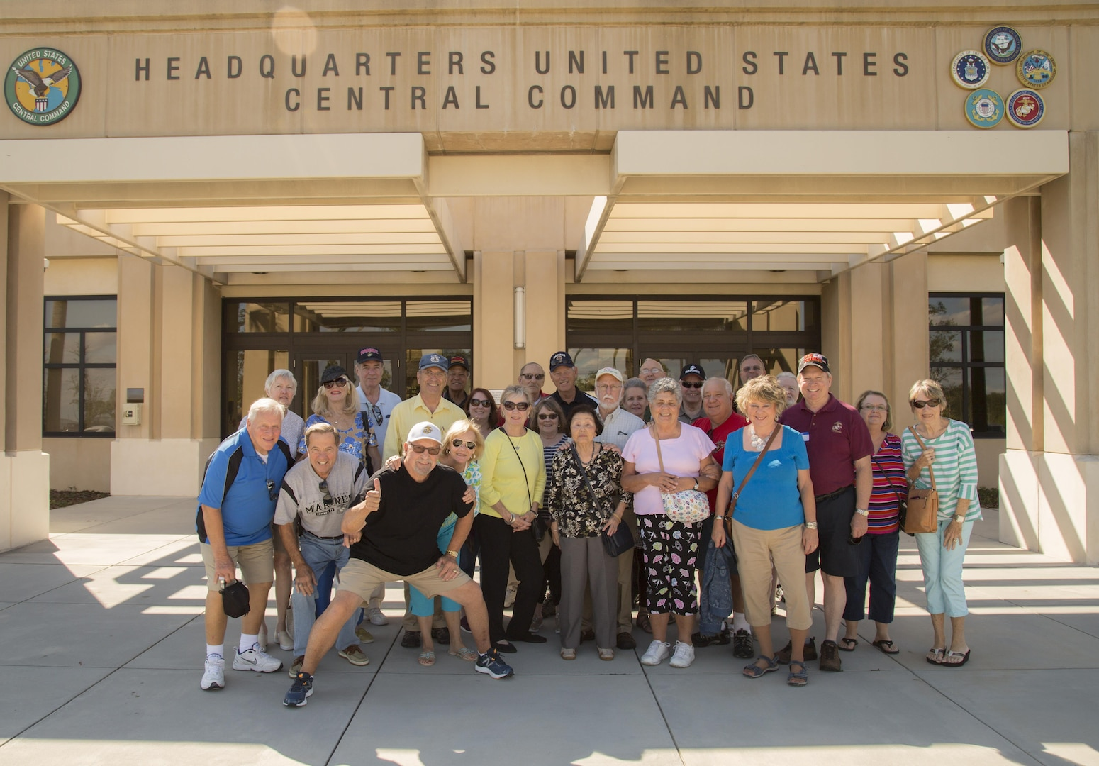 Marines of Marine Attack Squadron (VMA) 225 and spouses pose for a photo following a tour at U.S. Central Command headquarters, November 3, 2017. (Department of Defense photo by Tom Gagnier)