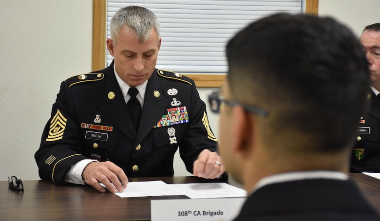 308th Civil Affairs Brigade Command Sgt. Maj. Thomas Walsh questions Spc. Pedro Benavides, from 407th Civil Affairs Battalion, during an evaluation Board at the 353rd Civil Affairs Command Best Warrior Competition at Fort McCoy, Wisconsin, November 4, 2017.