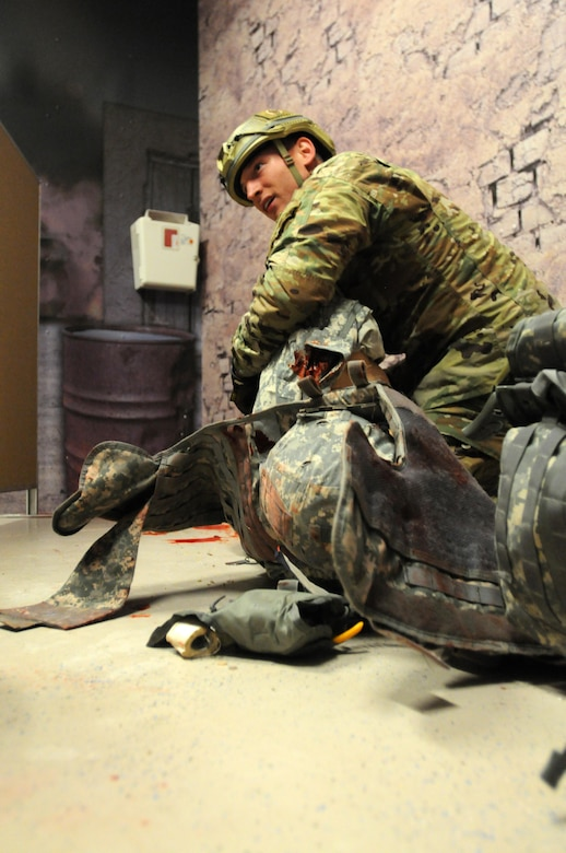 Competitor Staff Sgt. Loren Keeler, from 407th Civil Affairs Battalion, assesses and treats a simulated casualty during the 353rd Civil Affairs Command Best Warrior Competition held at Fort McCoy, Wisconsin, November 1, 2017. Keeler went on to win the title of 353rd CACOM 2017 Non-Commissioned Officer of the Year. (U.S. Army Reserve photo by Zach Mott, 88th Regional Support Command Public Affairs Office)
