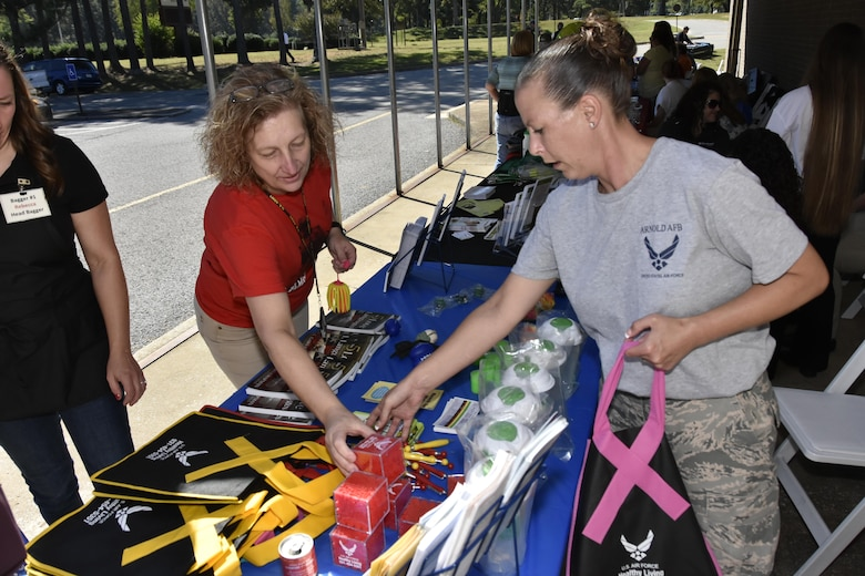 Tech. Sgt. Beverly Spademan (right), a non-commissioned officer in charge of Medical Administration at Arnold Air Force Base, discusses services offered at the Medical Aid Station with an employee during the Arnold Air Force Base Community Health Fair Sept. 29. More than 100 military and civilian visitors attended the health fair. (U.S. Air Force photo/Rick Goodfriend)