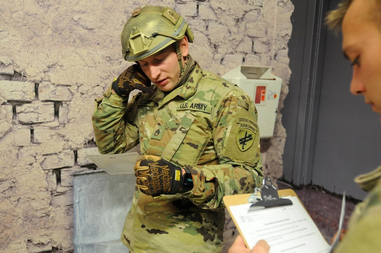 Staff Sgt. Loren Keeler, 407th Civil Affairs Battalion, completes a nine-line MEDEVAC notification during the 353rd Civil Affairs Command Best Warrior Competition at Fort McCoy, Wisconsin, November 1, 2017. Keeler went on to win the title of 353rd CACOM 2017 Non-Commissioned Officer of the Year. (U.S. Army Reserve photo by Zach Mott, 88th Regional Support Command Public Affairs Office)
