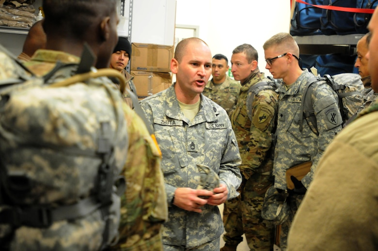 Sergeant 1st Class Nuhi Zhuta, center, from the 304th Civil Affairs Brigade, goes over final instructions for the Best Warrior competitors during a medical evaluation at Fort McCoy, Wisconsin, November 1. Zhuta and other members of the 304th Civil Affairs Brigade evaluated the 10 competitors during the event. (U.S. Army Reserve photo by Zach Mott, 88th Regional Support Command Public Affairs Office)