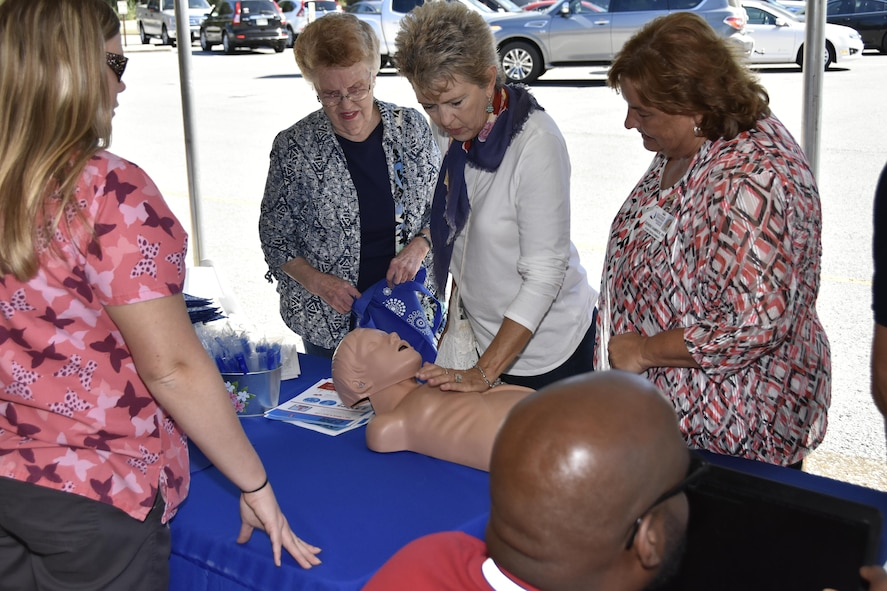 Participants at the Arnold Air Force Base Community Health Fair Sept. 29, experience the feel of administering CPR through one of the exhibitors. The health fair was hosted by the Arnold AFB Medical Aid Station. Health and Safety professionals were on hand to talk about diabetes, ergonomics, dental health, tobacco cessation, heart disease, physical therapy, nutrition, emergency preparation and fire extinguisher safety from the Arnold AFB Fire Department. (U.S. Air Force photo/Rick Goodfriend)